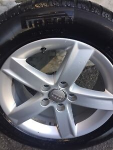 "16"" Audi oem mags with Pirelli winter tires.    nego."