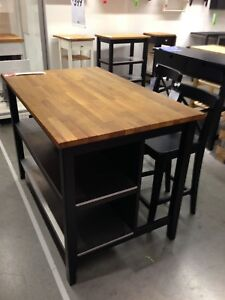 - - Kitchen island with stools