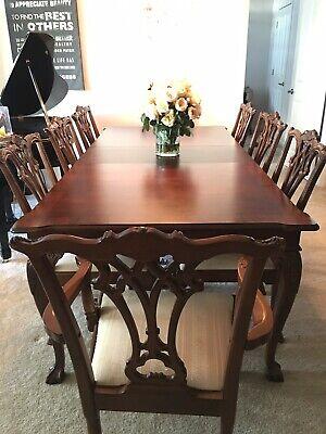 Stately Mahogany And Cherry Dining Room Set with 8 Hand-Carved Chairs