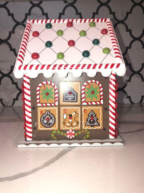 hearthsong gingerbread house advent calendar- Wooden Gingerbread House