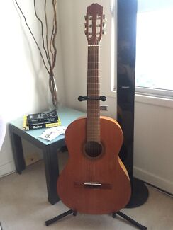 Beautiful acoustic guitar, stand, tuner and books set