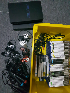 2 PS2 consoles + 34 games + singstar