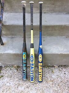 2 older softball bats