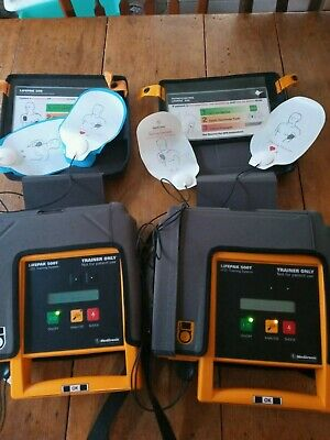 Lot Of 2 Medtronic Physio-control Lifepak 500t Aed Trainers With Leads Remotes
