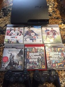 PS3 slim 500 GB with two controllers and 6 games