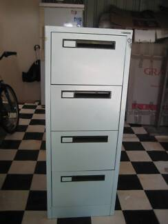 Four drawer filing cabinet with keys