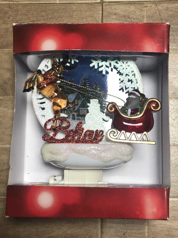 At Nicholas Square Christmas Night Light Believe Santa