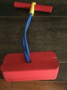 Jumping pogo stick type toy