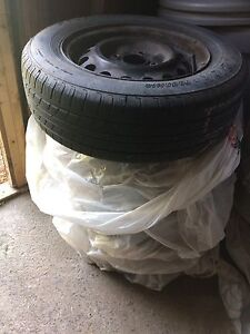 4 GREAT condition ALL SEASONS Fuzion tires 14 inch on rims