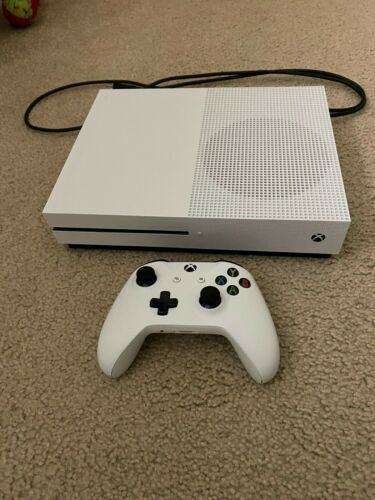 White Xbox one 1Tb bought last year barely used and in good shape.