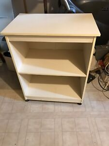 White rolling shelving unit.