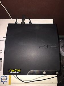 Sony ps3 slim. 2 games