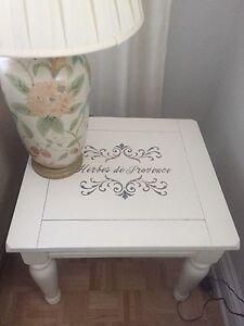Set of two hard wood tables vanilla white