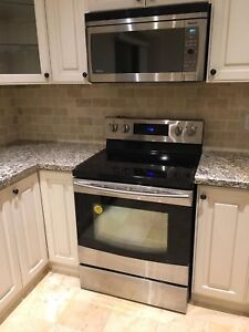 Samsung stainless stove, refrigerator and microwave hood set