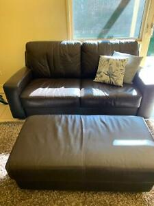 Couch, ottoman and large rug