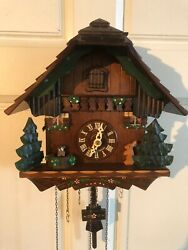 GERMAN CUCKOO CLOCK BLACK FORREST SWISS CHALET WITH MUSIC AND FOUR FUNCTIONS