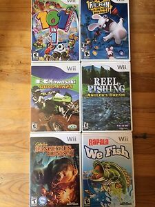 6 wii games and 2 controller holders