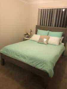 Queen bed with headboard and mattress
