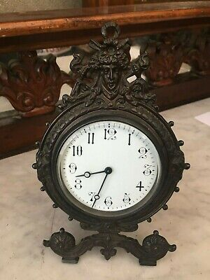 Antique cast bronze strut mantle clock in good working order with key
