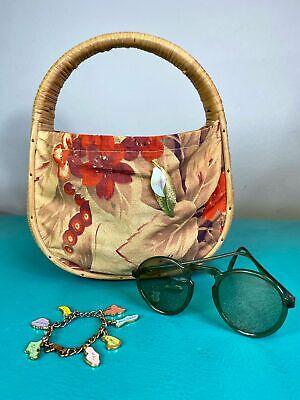 1940s Handbags and Purses History Vintage 1940s Handbag • Straw and Floral Butterfly Barkcloth Purse $62.00 AT vintagedancer.com