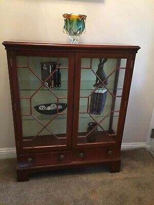 Astral glazed display cabinet with drawers