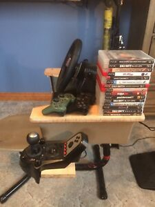 PS3 + G27 racing wheel + 2 controllers + 15 games
