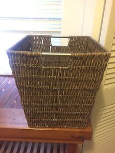 Small wicker waste paper basket with metal handle detail
