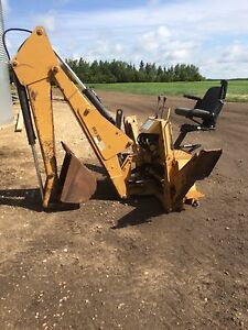 1050 Woods Backhoe, IMT Picker and McMillan post hole Auger