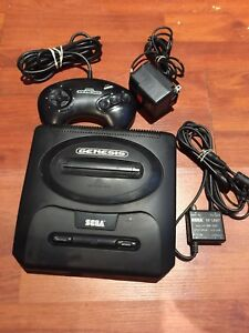 Sega Genesis video game console works excellent