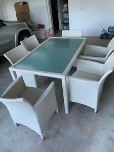 7 piece white wicker outdoor setting. Always stored under cover.