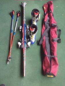 Performance Salomon skis, boots, binders, poles and ski bag