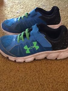 Blue boys under armour running shoes