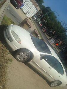 (306)209-8836. 2003 Chrysler 4d white 300$