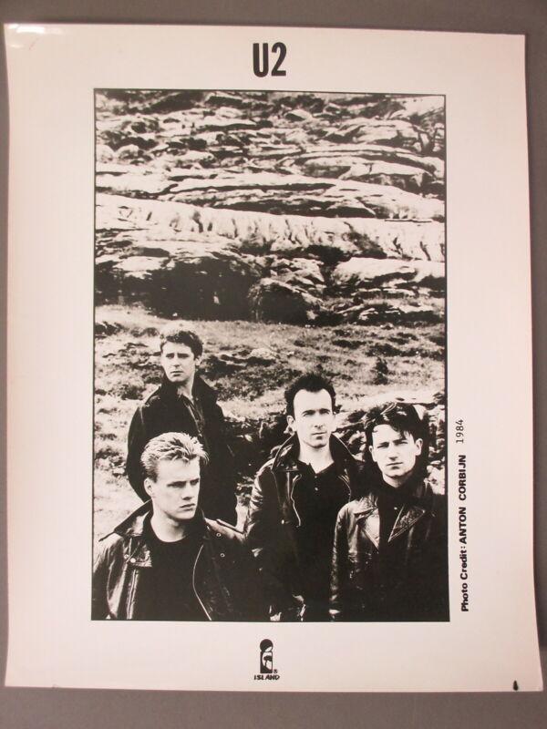 U2 promo photo 8 X 10 glossy black & white with rocks behind them !