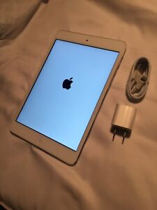 Mint Condition iPad mini two with brand new charger asking 200