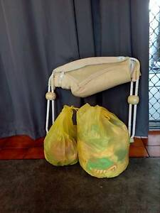 fisher price  baby rocker and 1 1/2 bags of girl clothing. Yorkeys Knob Cairns City Preview