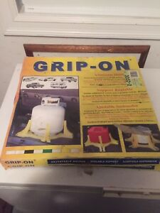 Grip on stands for gas jugs, propane tanks, etc.