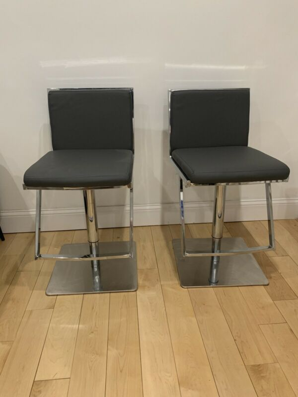 Two Armen Living Ibiza Adjustable Stainless Steel Barstools in Gray Faux Leather