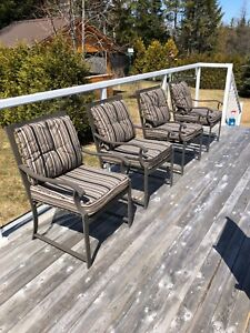 35.00 ea Out door chairs with cushions and 70.00 glass table