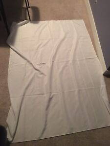 Two white canvas sheets
