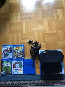 PS Vita w/ 8GB memory card + 5 games + Carrying case