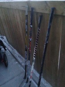 Four barely used hockey sticks