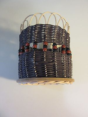 DECORATIVE  WOVEN BASKET WITH BEADS AND WOODEN BASE