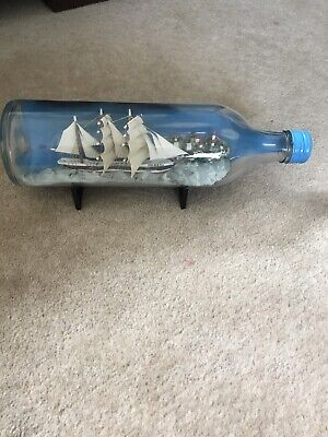 VINTAGE SHIP IN BOTTLE WITH LOTS OF SAILS