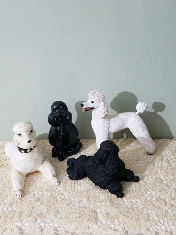 4 vintage poodle figurines resin, porcelain.  FC statuary, Conversation concepts