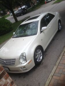 CADILLAC STS PEARL WHITE