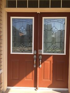 Double doors, glass inserts and privacy shutters