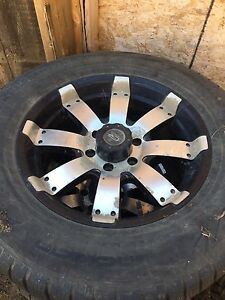 "Ford F-150. 6 x 135 18"" rims and tires"