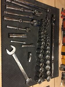 Gray Canada ratchet, socket, extensions, wrench