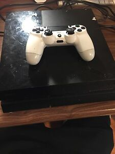 PS4 with a controller and battlefield